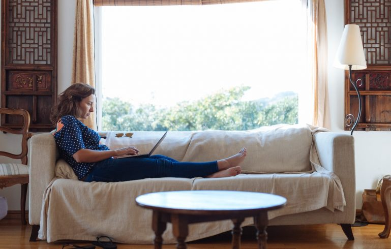 woman on sofa in a condo with a classic interior