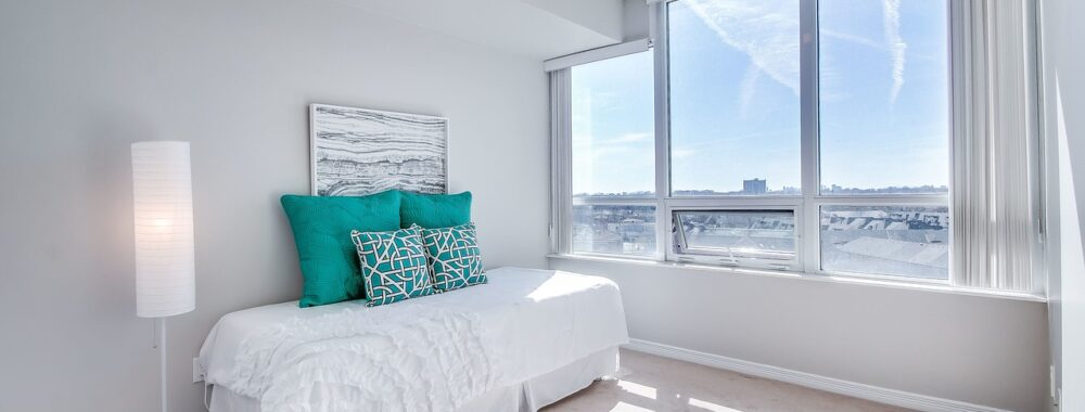 This is an image of a minimalist condo bedroom design