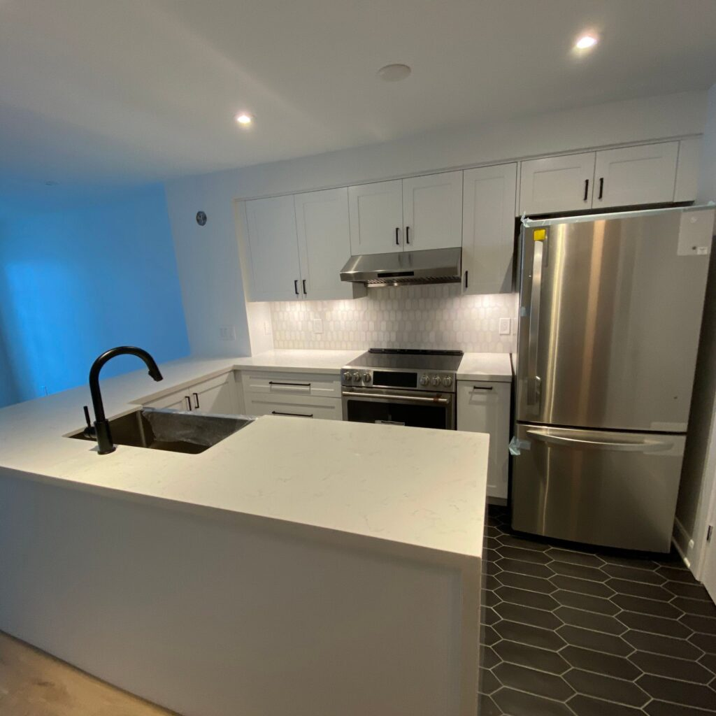 modern condo kitchen remodel with ceiling potlights