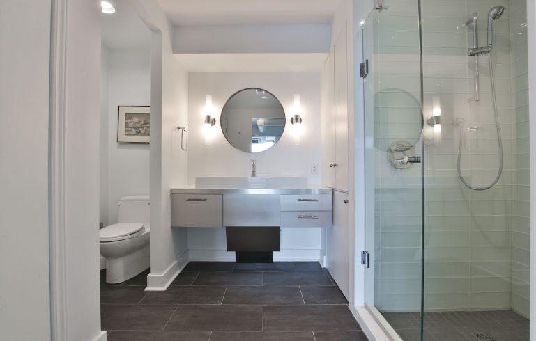 condo bathroom with steel vanity and walk in shower - condo bathroom renovations toronto
