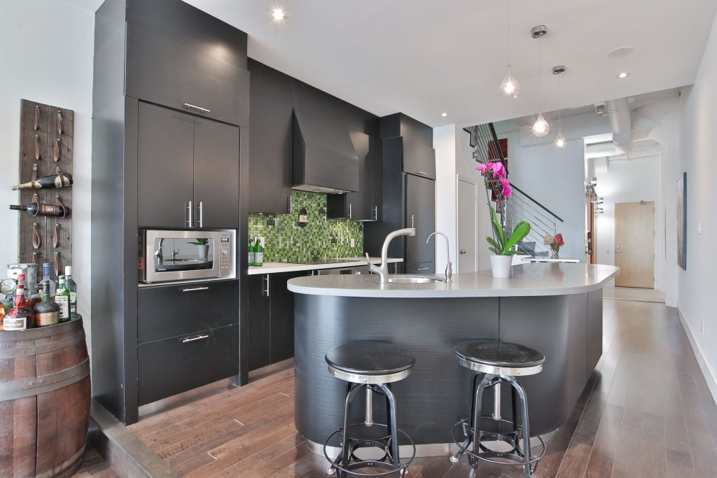 custom condo kitchen with wooden floor and brown wood kitchen cabinets - kitchen condo renovations
