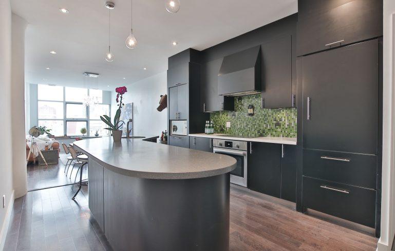 green backsplash wall in amazing kitchen - condo kitchen reno