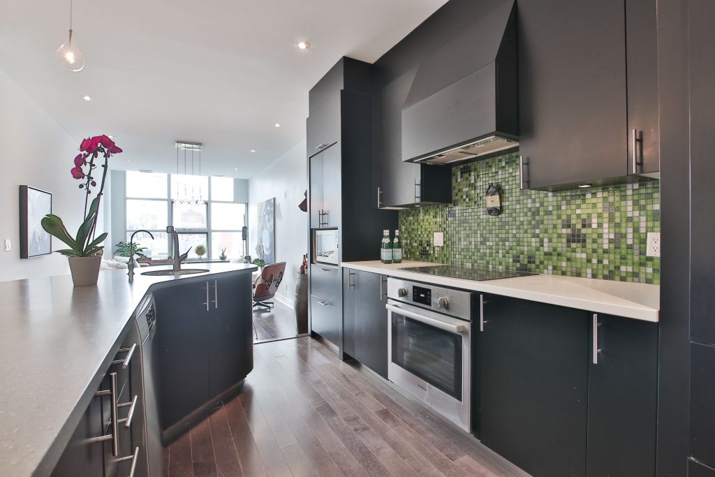 classic condo kitchen with brown wood cabinets and build in appliance - condo kitchen reno markham