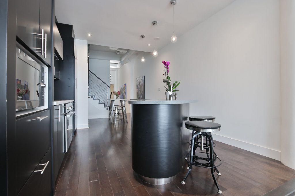 condo kitchen with kitchen island and build in appliances - condo kitchen renovation ideas maple