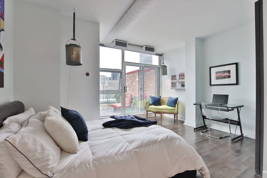 custom condo bedroom with wooden floor and work desk - condo renovations etobicoke