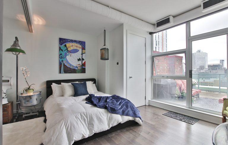 luxury bedroom with floor carpet art paintng wall decor - condo renovations north york