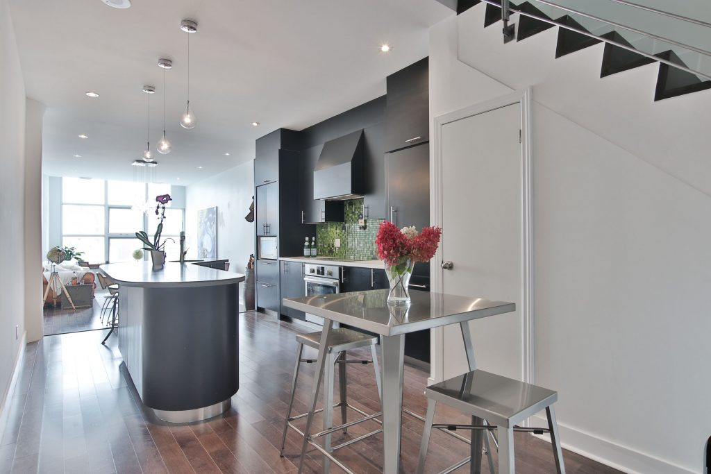 luxury condo apartment with open space kitchen and dining room - condo renovation