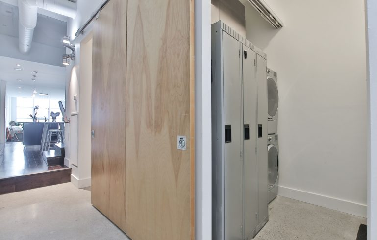 small laundry and looker room in amazing condo